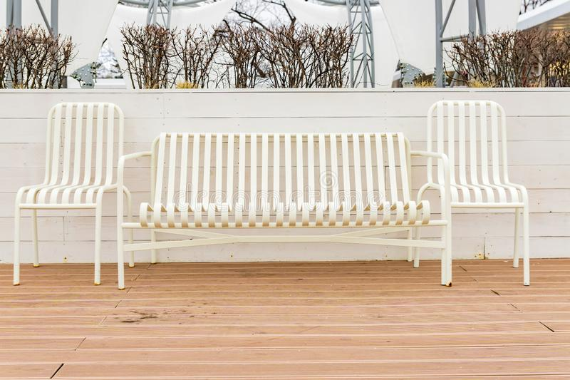 Empty street bench and chairs.  Relax zone in the city. Empty street bench and chairs. Relax zone in the city royalty free stock image