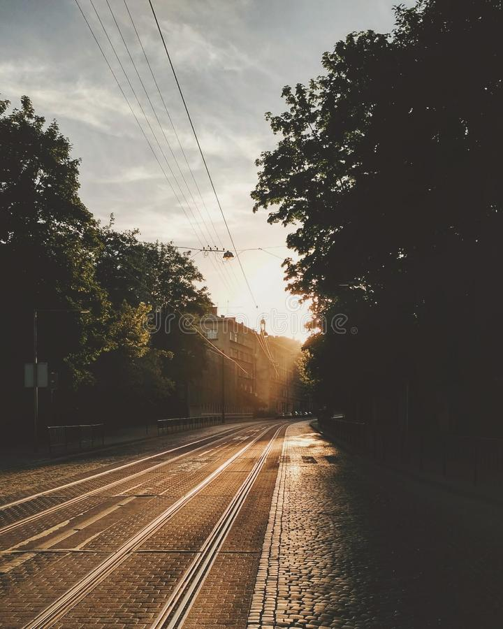 Empty street in city in summer sunny day. Railway without transport. Empty street in city in summer day. Sunny road. Railway without transport stock photo