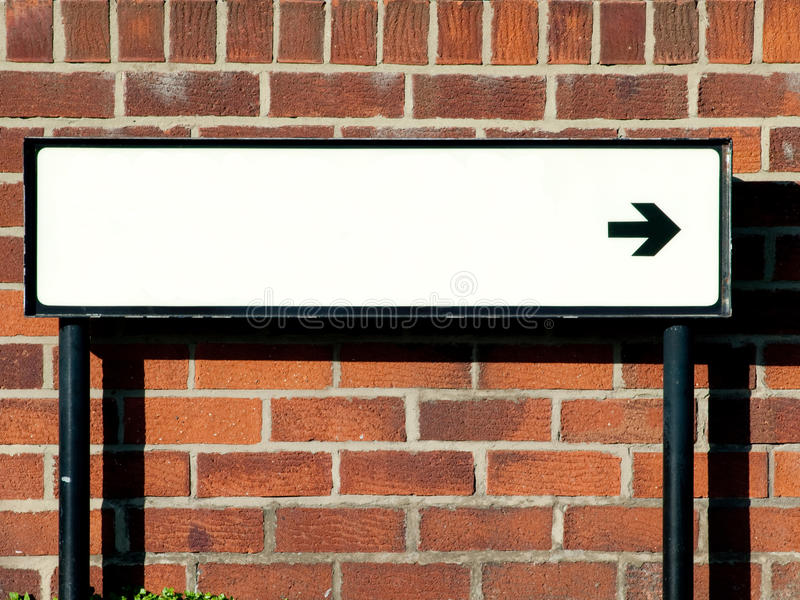 Empty Street Direction Sign Against A Brick Wall Stock ...