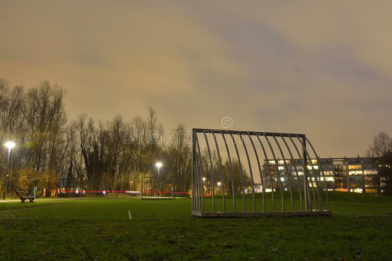 Empty street soccer field at night. With goals made of iron bars stock photography