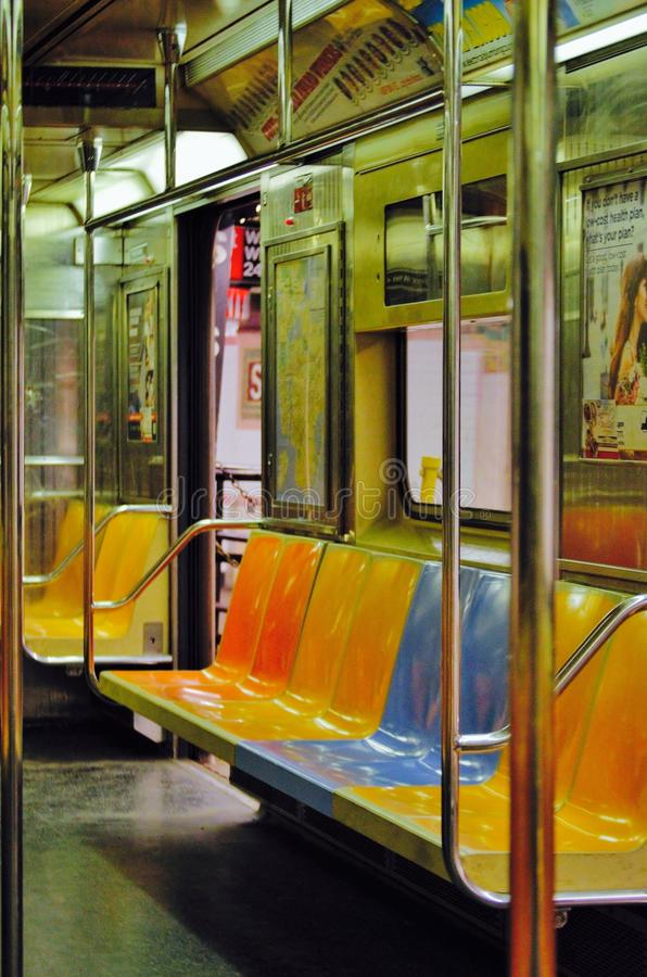Empty subway. NYC mta public transit transportation geometric lines stairs stairway empty solitary hard concrete steel b train d train uptown Bronx queens royalty free stock photo