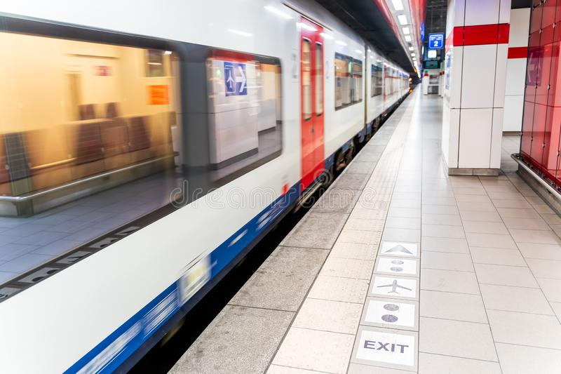 Empty subway station with speeding train, Brussels Belgium. Empty subway station with speeding train, motion blur, Brussels, Belgium royalty free stock photography