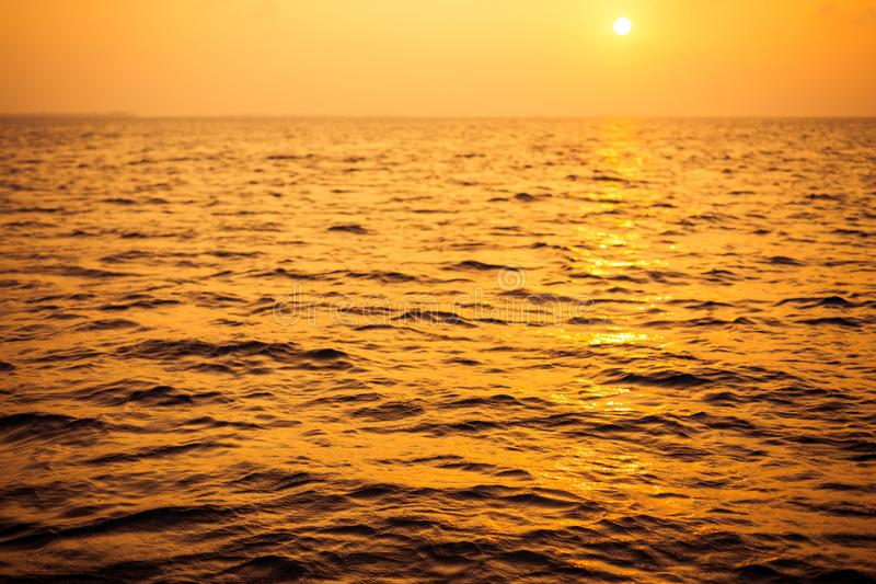 Empty sunset sea background. Horizon with sky and white sand beach royalty free stock images