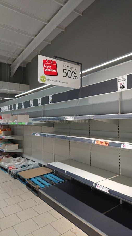 Empty supermarket shelves royalty free stock photos