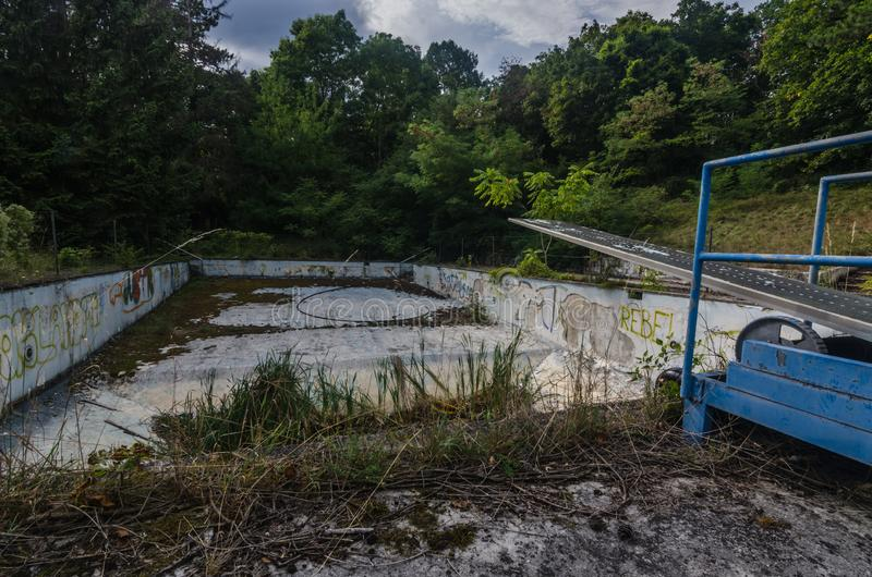 empty swimming pool in a forest stock photos