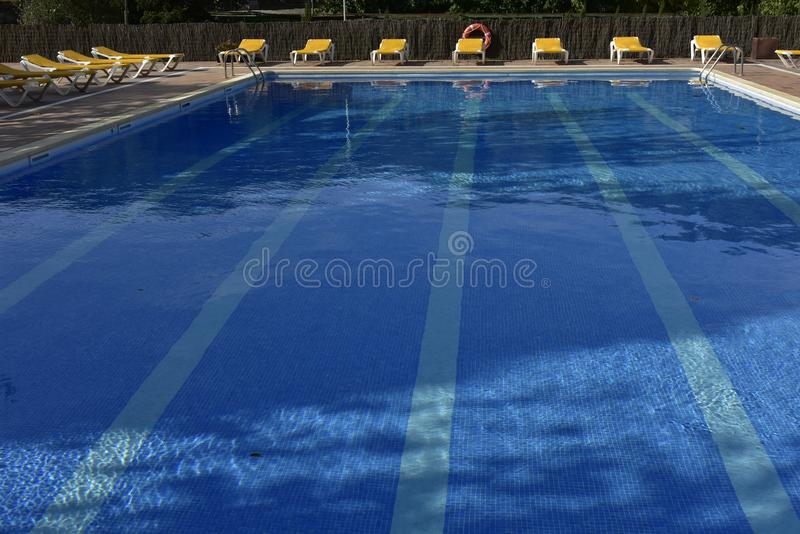 Empty swimming pool with clean water royalty free stock photography