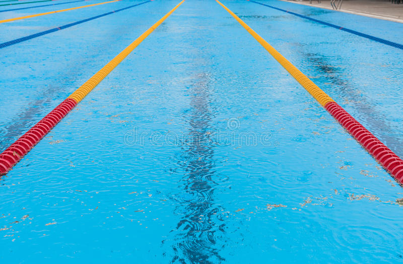Empty Swimming Pool and rain. Empty Swimming Pool Because of the bad Rainy Weather royalty free stock photo
