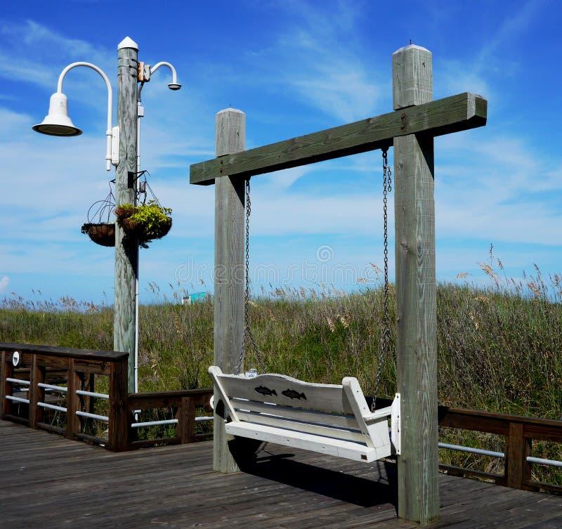 Empty swing on the beach, Carolina Beach, North Carolina. Empty swing on the beach, Carolina Beach Boardwalk, NC, USA stock photo