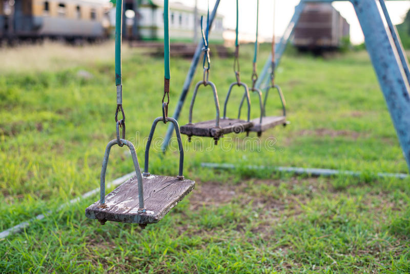 Empty swing on children playground in city. stock image