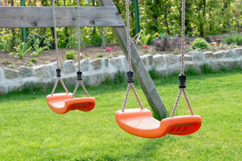 Empty swings in the garden royalty free stock images