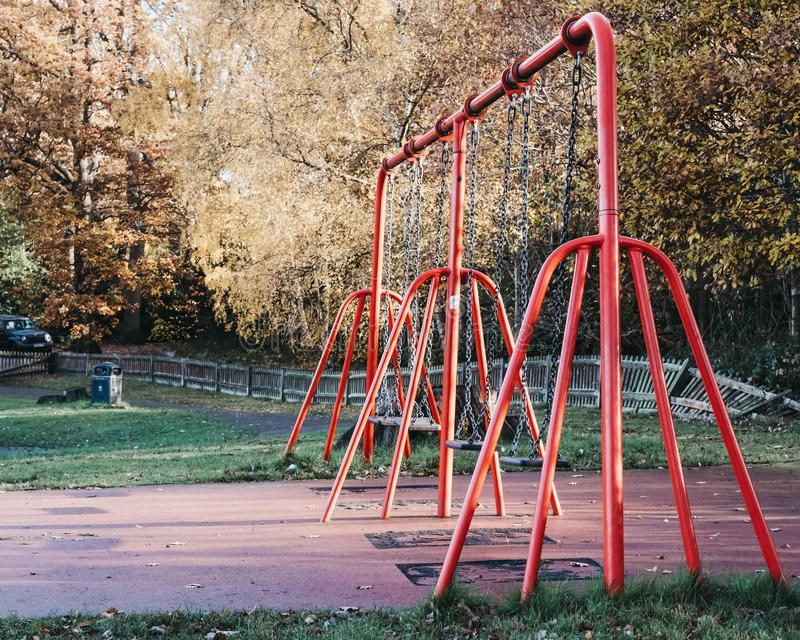 Empty swings in a park royalty free stock photo