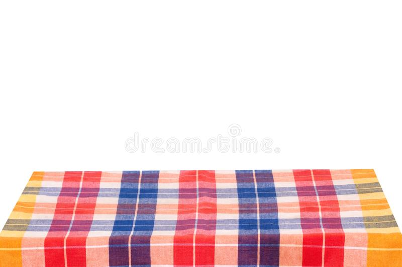 Empty table background. Empty wooden deck table covered with multicolored checkered tablecloth isolated on a white background. royalty free stock photography