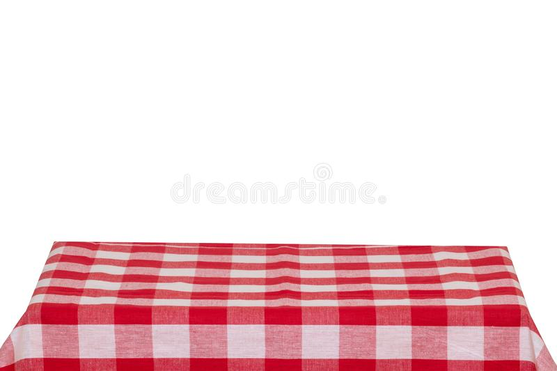 Empty table background. Empty wooden deck table covered with red white checkered tablecloth isolated on a white background. Space stock photography