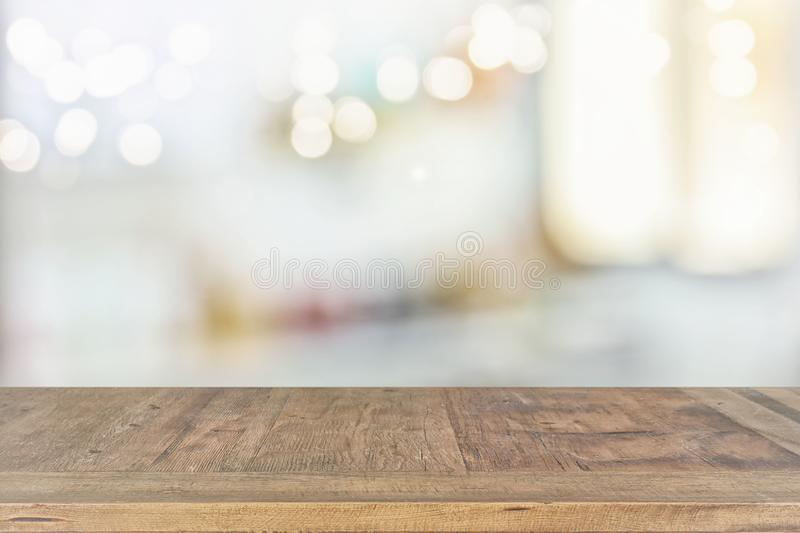 empty table board and defocused bokeh lights background. product display and picnic concept royalty free stock photography