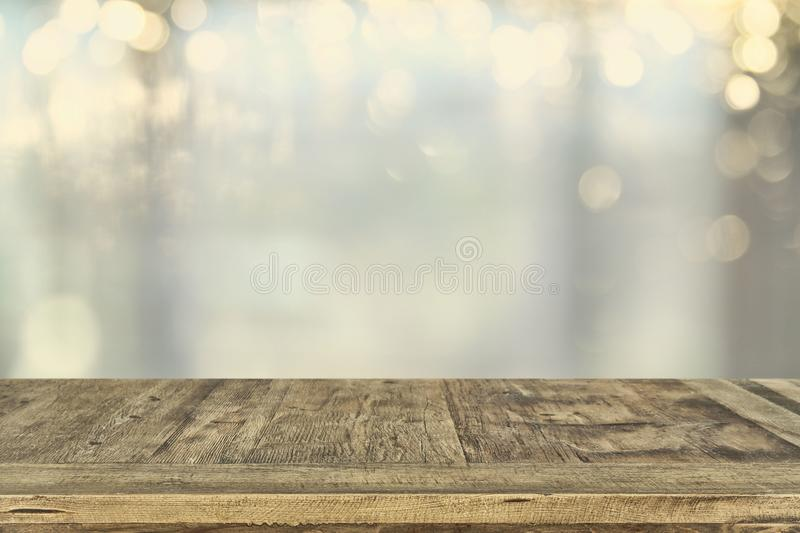 empty table board and defocused bokeh lights background. product display and picnic concept royalty free stock photo