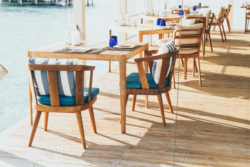 Empty table and chair decoration in restaurant. Beautiful empty table and chair decoration in restaurant royalty free stock photography