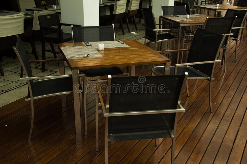 Empty table and chair in restaurant. Interior of  modern restaurant with wooden floor royalty free stock images