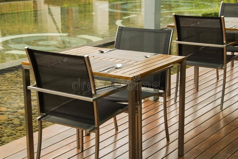 Empty table and chair in restaurant. Interior of  modern restaurant with wooden floor stock image