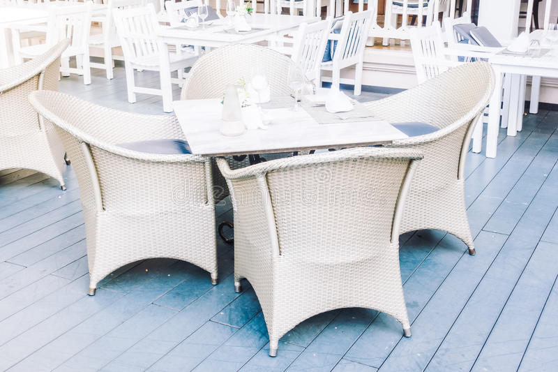 Empty table and chair. Setting for dinning in restaurant - Vintage Light Filter royalty free stock images