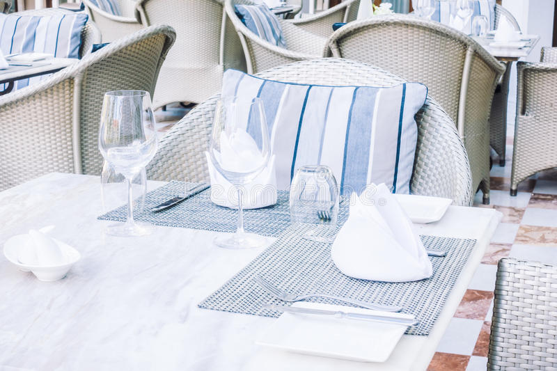 Empty table and chair. Setting for dinning in restaurant - Vintage Light Filter royalty free stock image