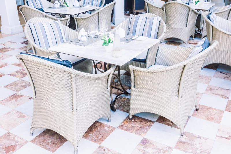 Empty table and chair. Setting for dinning in restaurant - Vintage Light Filter royalty free stock photos