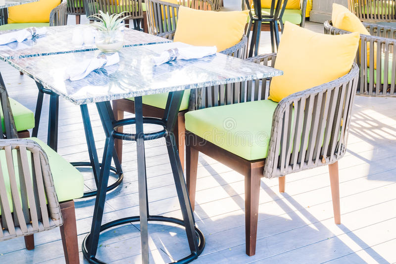 Empty table and chair. Setting for dinning in restaurant - Vintage Light Filter stock image