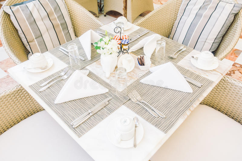 Empty table and chair. Setting for dinning in restaurant - Vintage Light Filter royalty free stock photo