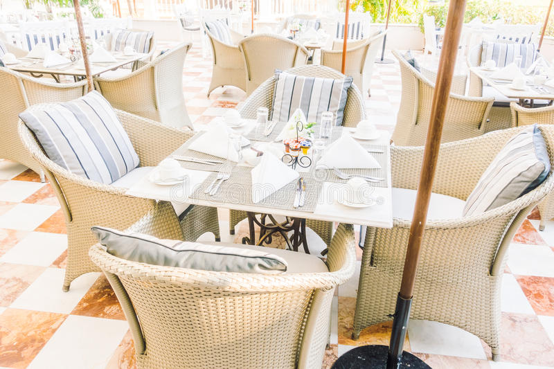 Empty table and chair. Setting for dinning in restaurant - Vintage Light Filter stock images
