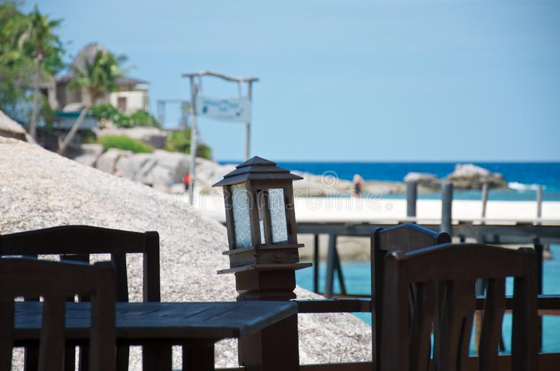 Empty table and chairs in a tropical beach restaurant stock image