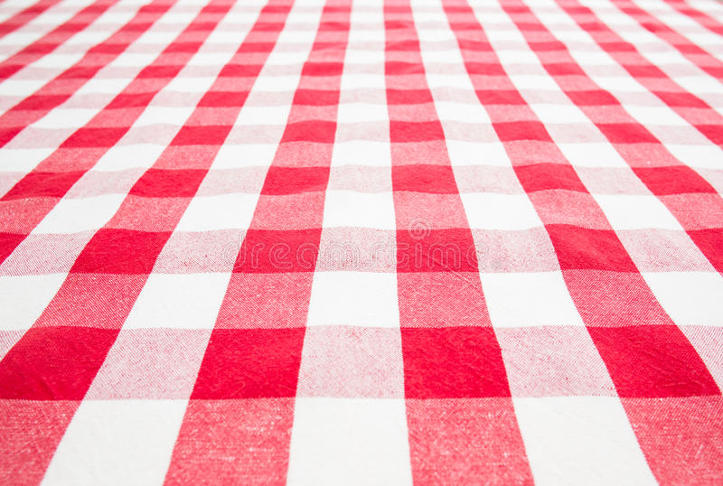 Empty table covered by red gingham tablecloth. Empty table top view covered by red gingham tablecloth stock image