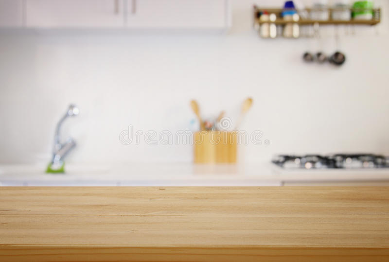 empty table and defocused modern kitchen background stock photo