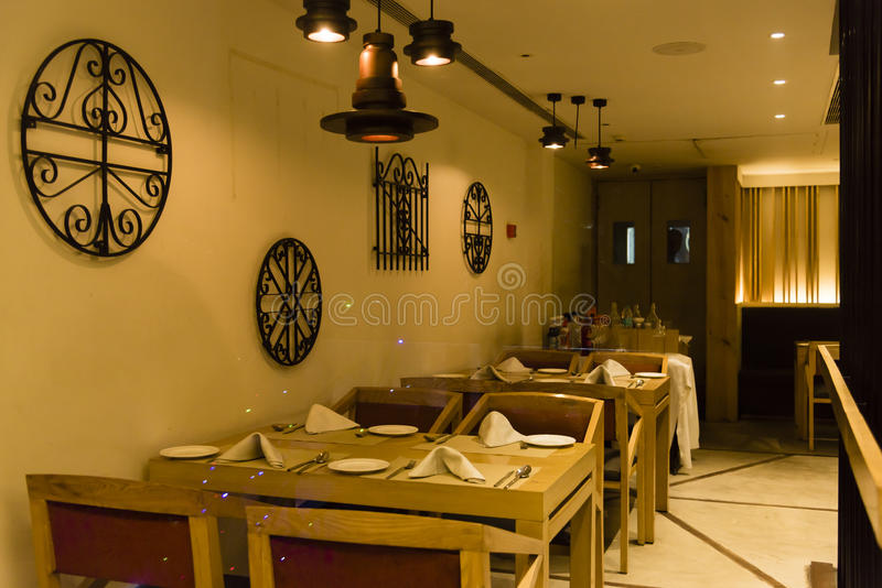 Empty table at a restaurant. Interior of a restaurant, empty table stock photo