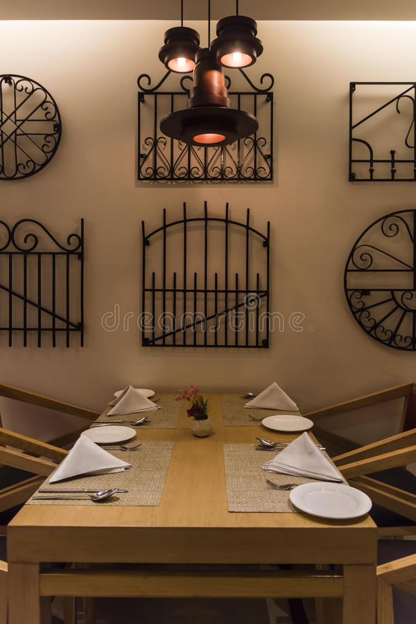 Empty table at a restaurant. Interior of a restaurant, empty table royalty free stock images