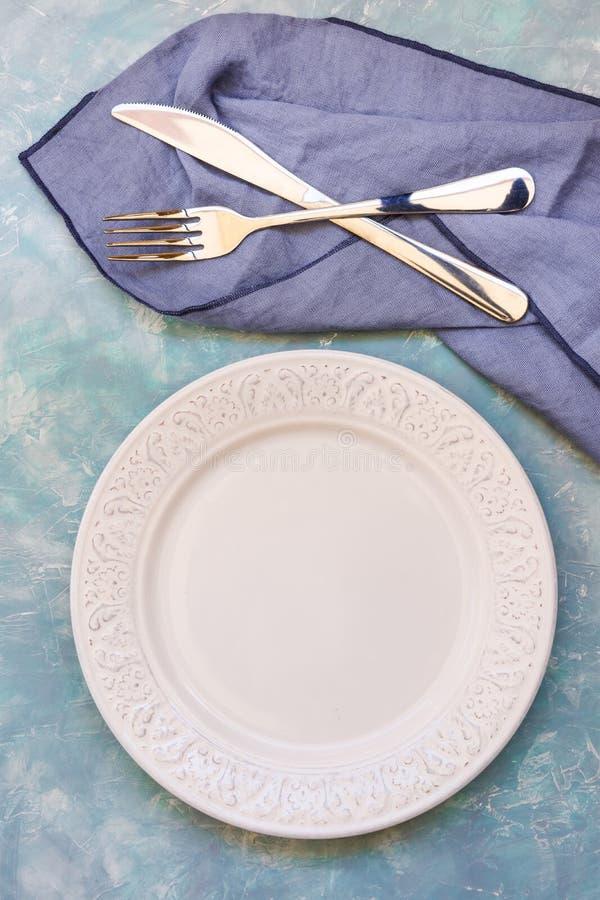 Empty Table Setting Arrangement, White Plate, Cutlery, Blue Napkin ...