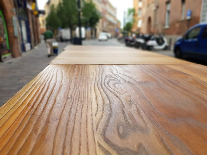 Empty table on the sidewalk outside in the street of town stock photos