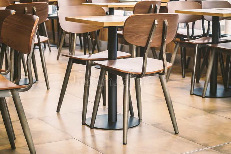 EMPTY TABLE TOP IN CAFE OR RESTAURANT, BACKDROP FOR FOOD AND DRINKS.WORKING AND TIME BUSINESS CONCEPT BACKGROUND.WAITING MEETING stock photo