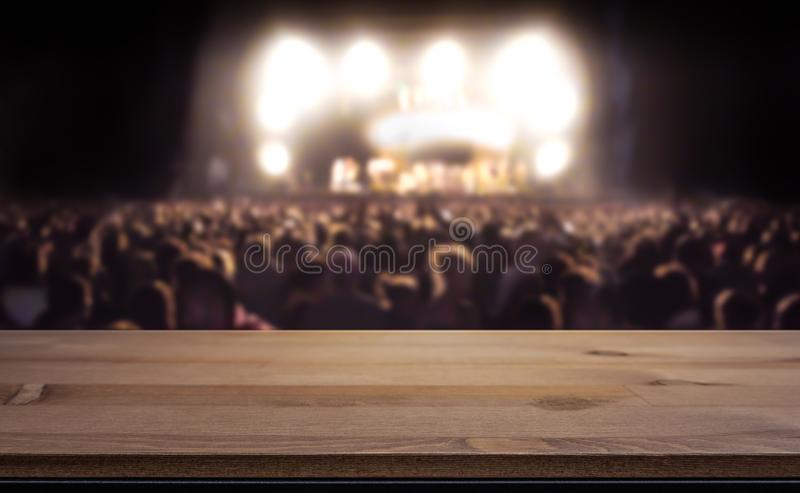 Crowd at concert, summer music festival blurred in the background royalty free stock images