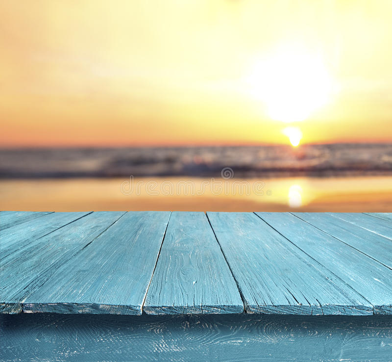 Empty table top at sunset beach stock photo
