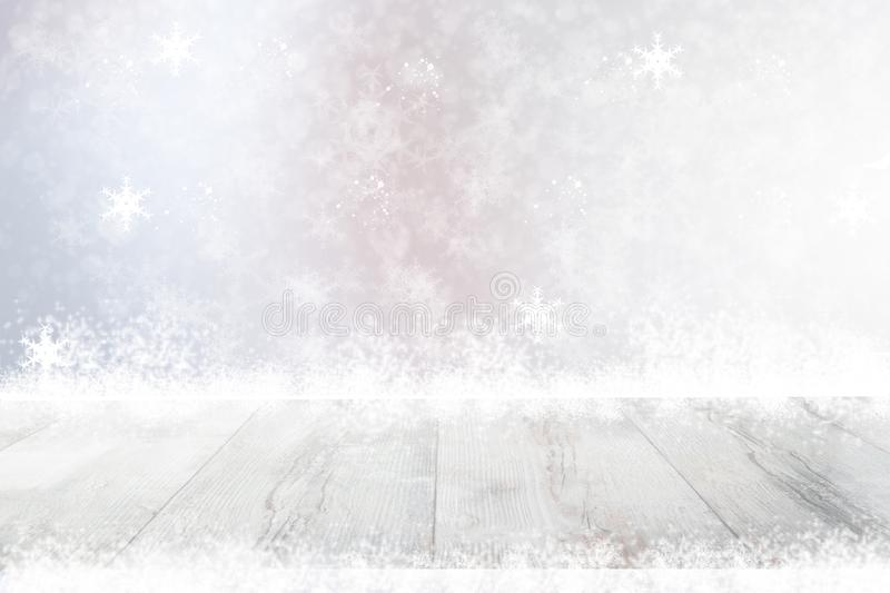 Empty table top or wood floor and blur abstract christmas of background. Empty rustic wooden bright table top with snow in front stock photography