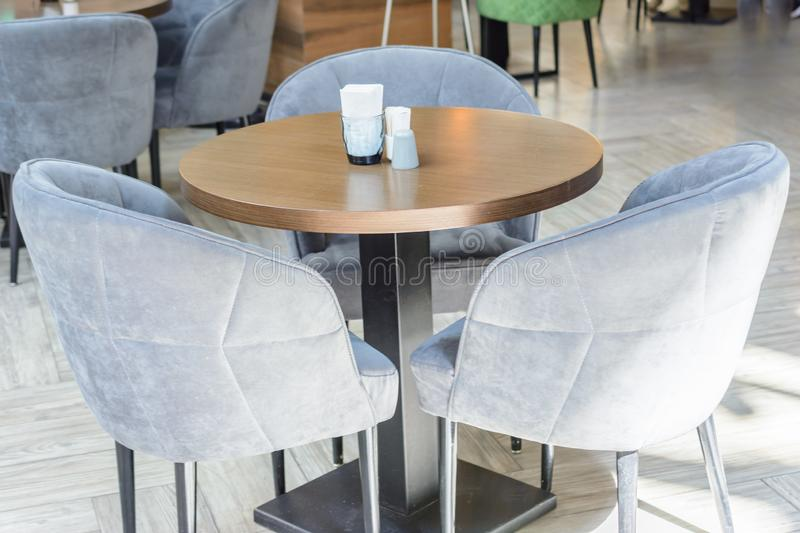 Empty tables in the cafe. No visitors, no tourists. Unsuccessful investments in the catering business royalty free stock photos