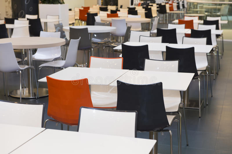 Empty tables and chairs stock photography