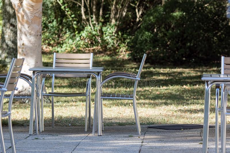 Empty tables and chairs outside cafe for al fresco dining. stock image