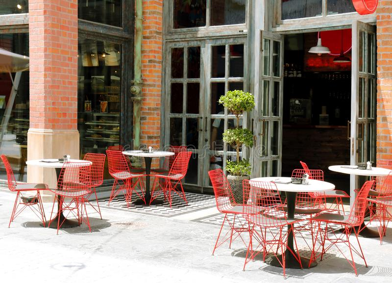 Empty tables and chairs in a street café. stock photography