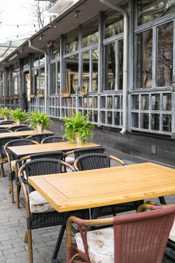 Empty tables in street cafe, chairs in street reastaurant royalty free stock image