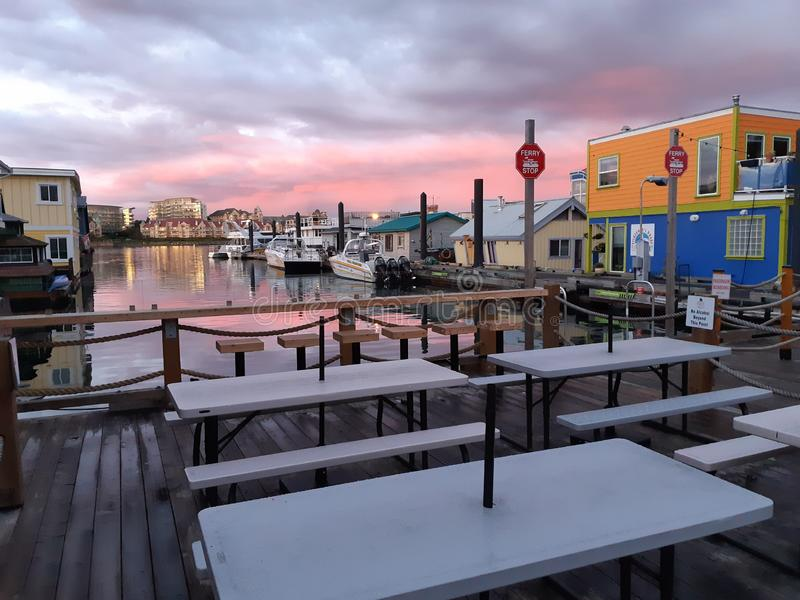Empty tables at Victoria Fisherman`s Wharf stock photos