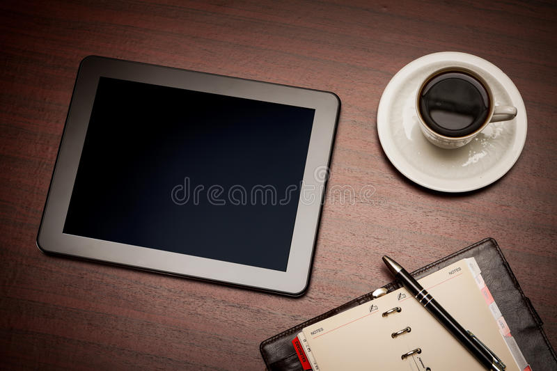 Empty Tablet And A Cup Of Coffee In Office Royalty Free Stock Images