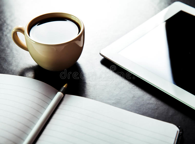 Empty tablet pc and a coffee and notebook with pencil royalty free stock images