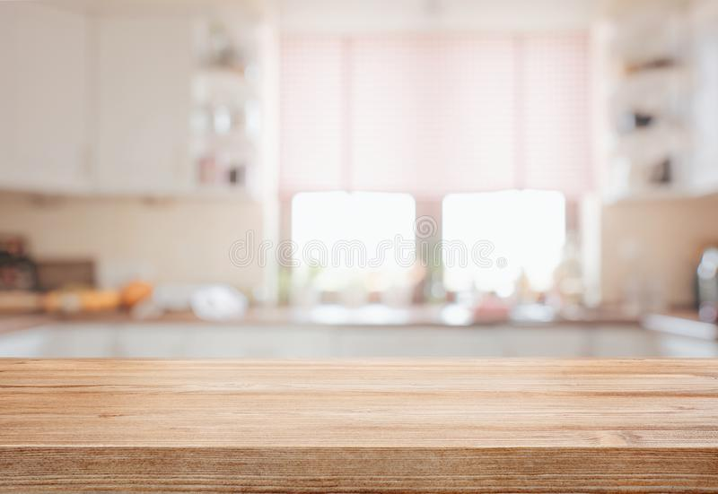 Empty tabletop over defocused kitchen stock photos