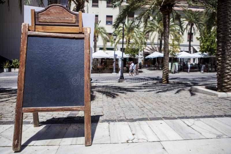 Empty tabloid offering food for terrace restaurants. Granada, Spain royalty free stock photos