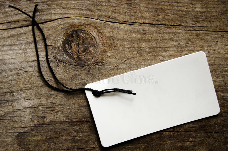 Empty tag. Over a textured wooden background stock photography